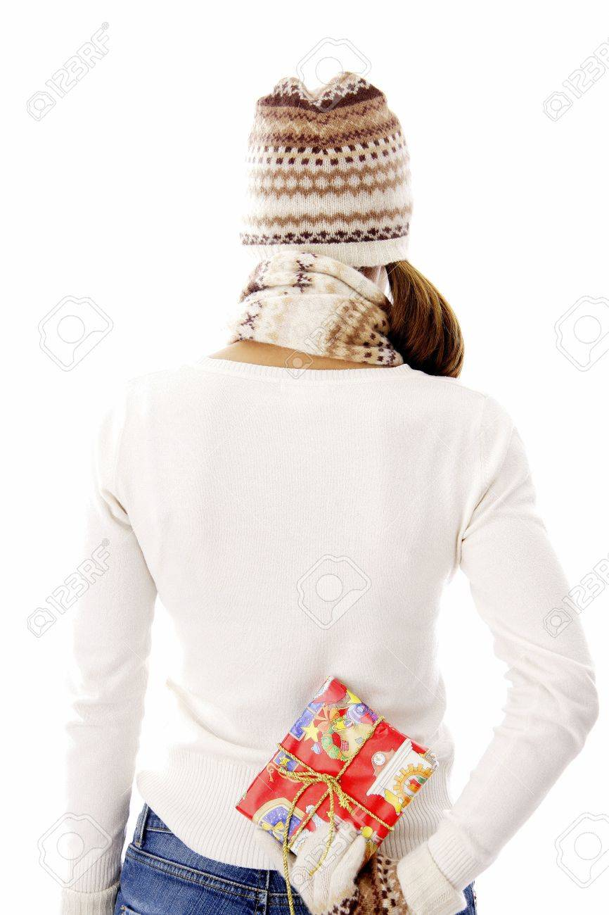 Woman holding a gift behind her back Stock Photo - 3192008
