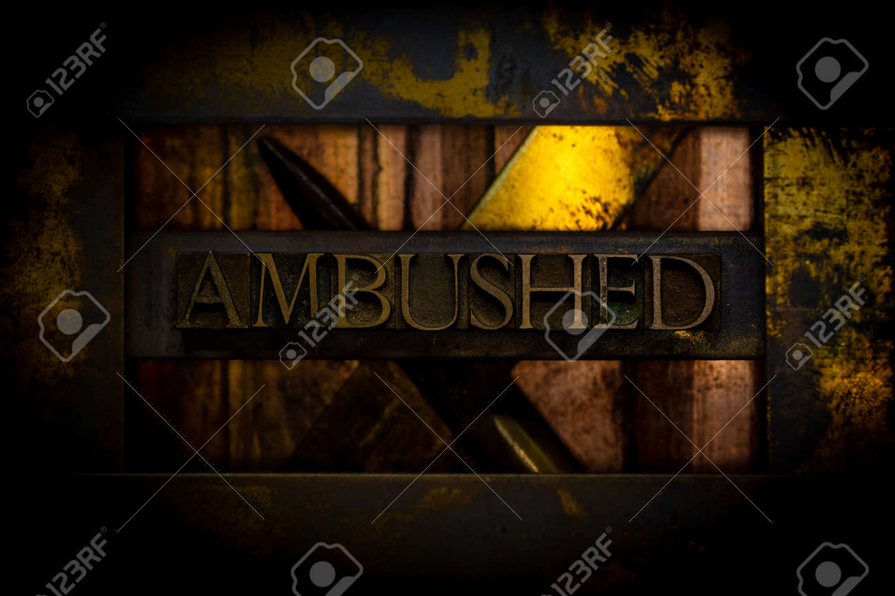 Ambushed text formed with real authentic typeset letters on vintage textured grunge darkened copper background - 155326200