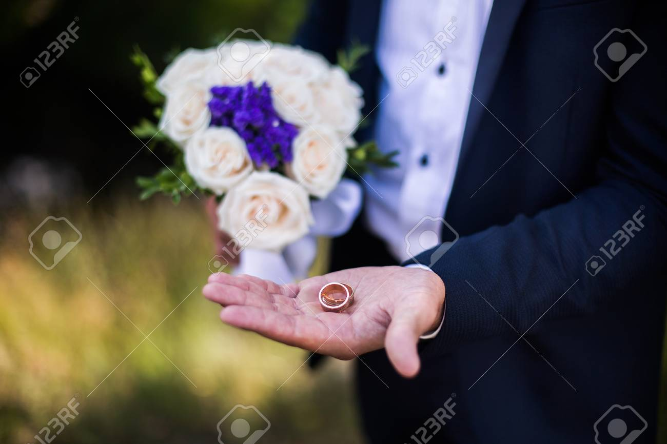 Groom Holding A Wedding Bouquet Of White Roses And Blue Flowers
