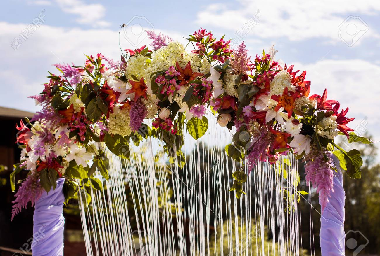 Wedding arch of red blue purple and white flowers marriage stock photo wedding arch of red blue purple and white flowers marriage registration the preparations for the wedding wedding decorations mightylinksfo