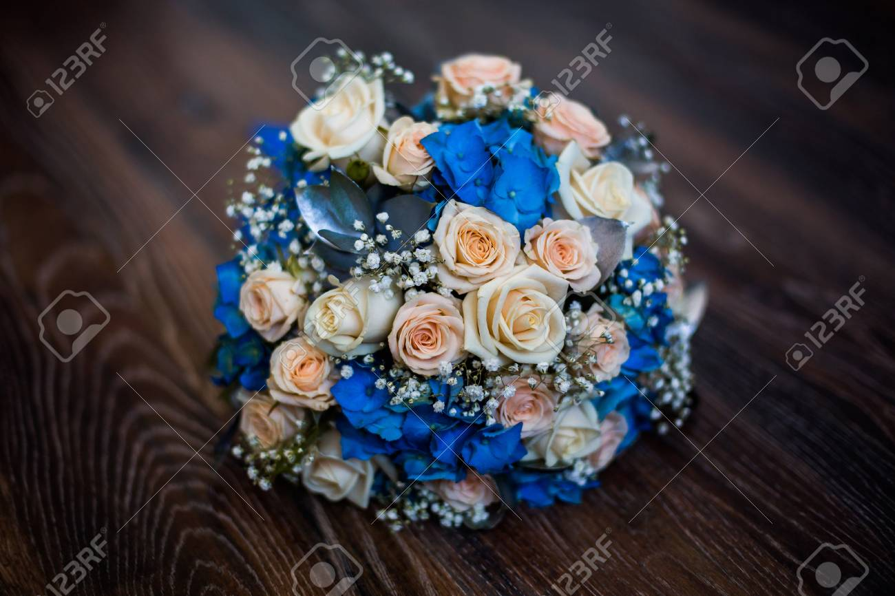 Wedding Flowers Bouquet Of Pink Roses And Blue Flowers Roses