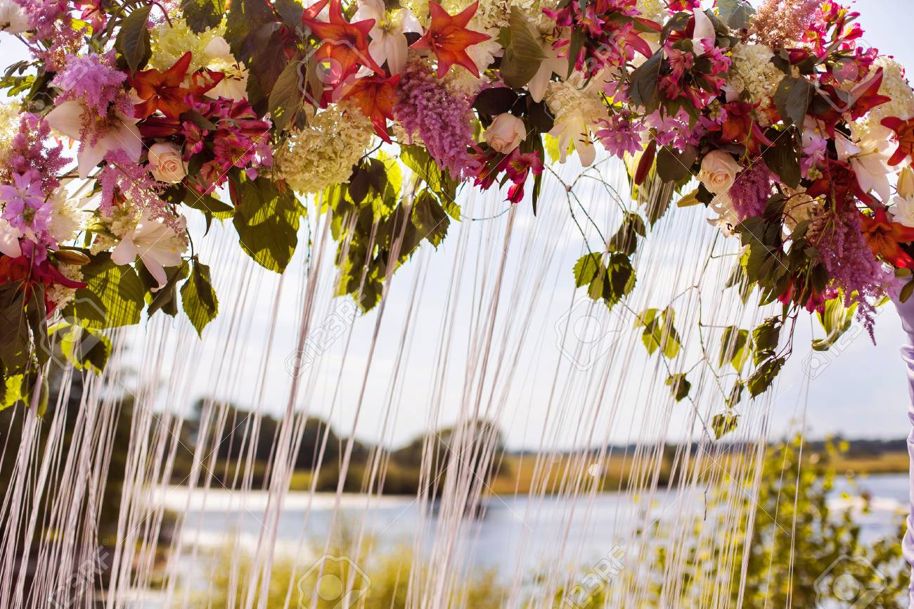 Wedding Arch Of White, Red, Yellow, Purple, Blue Flowers, Wedding ...