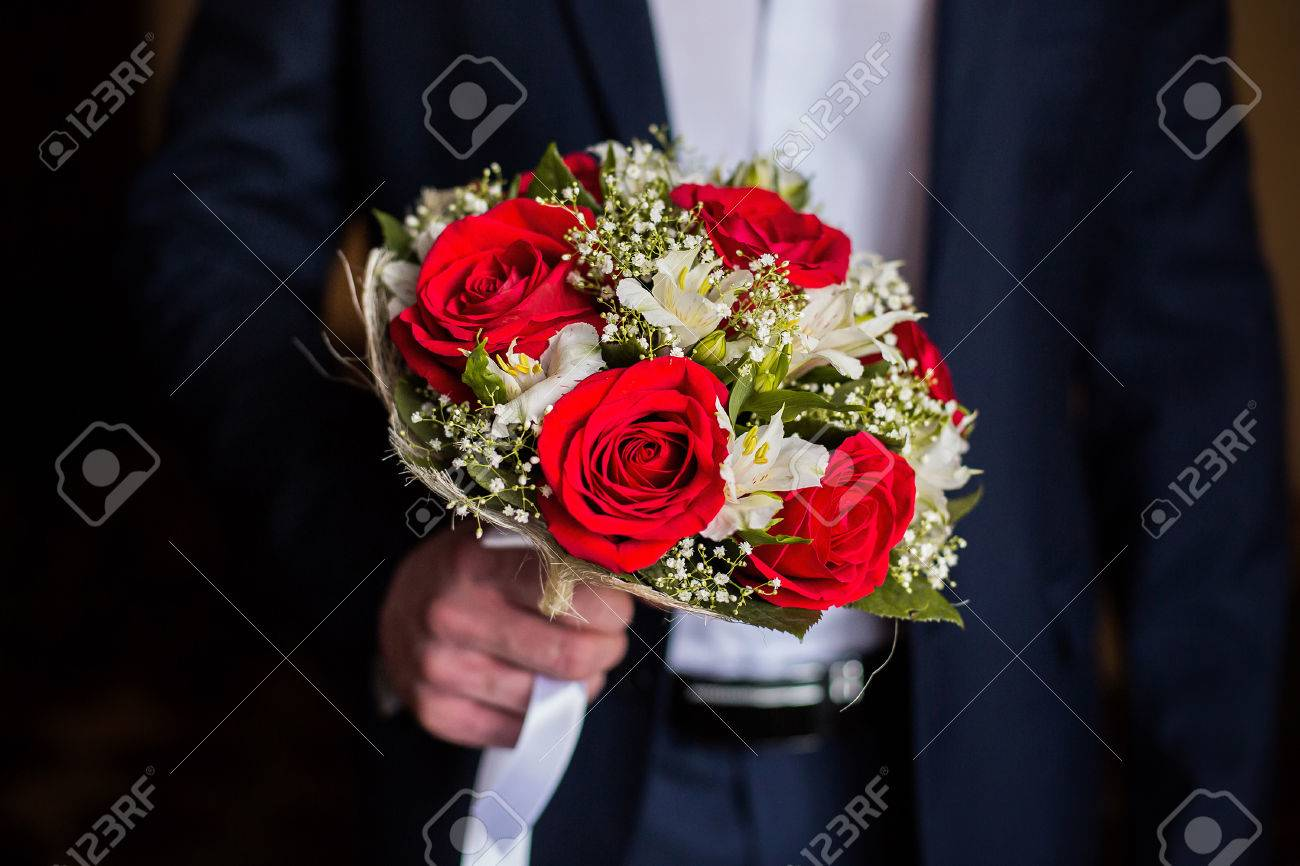 Red Rose Wedding Bouqet.Wedding Flowers Groom Holds Bouquet Of White Flowers And Red