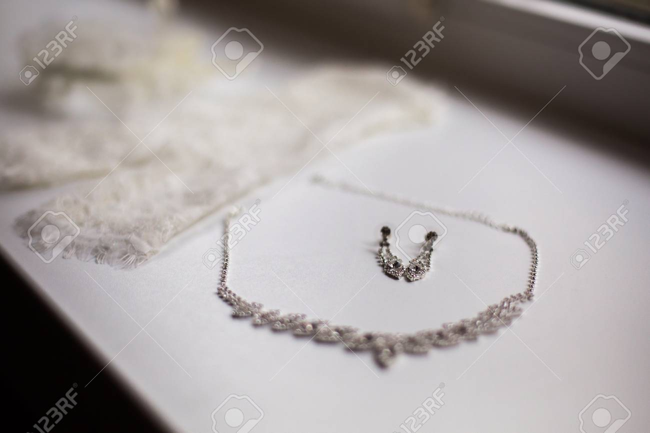 Garter Of The Bride, Women\'s Earrings And Chain Lie On A White ...