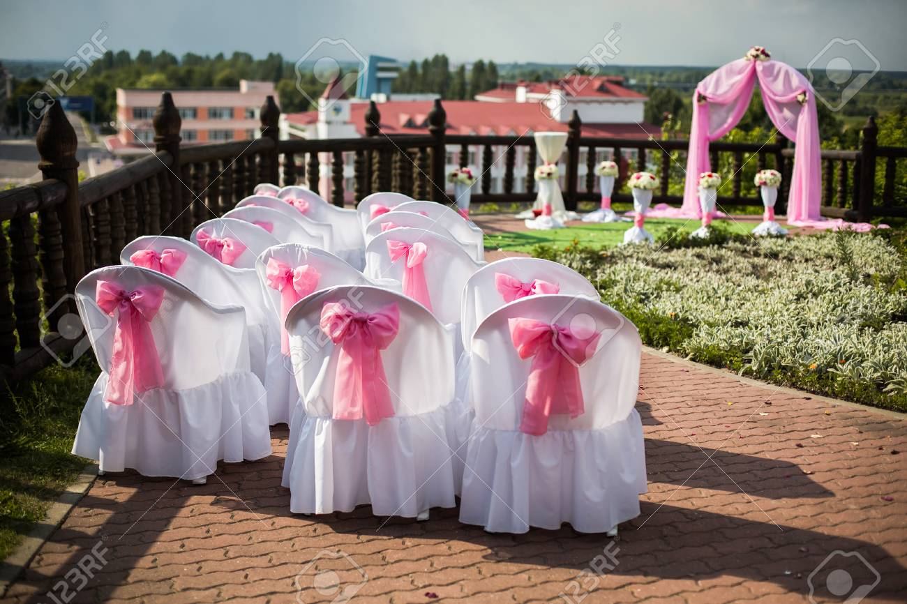 Visiting wedding registration white chairs decorated for wedding stock photo visiting wedding registration white chairs decorated for wedding pink wedding arch wedding flowers potted flowers white pink and red mightylinksfo