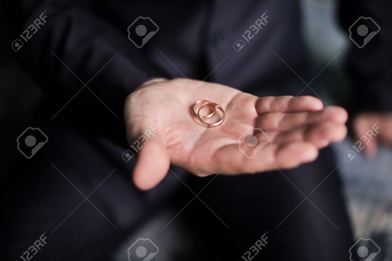 Gold Wedding Ring In A Man\'s Hand, The Groom Holding Rings, Wedding ...
