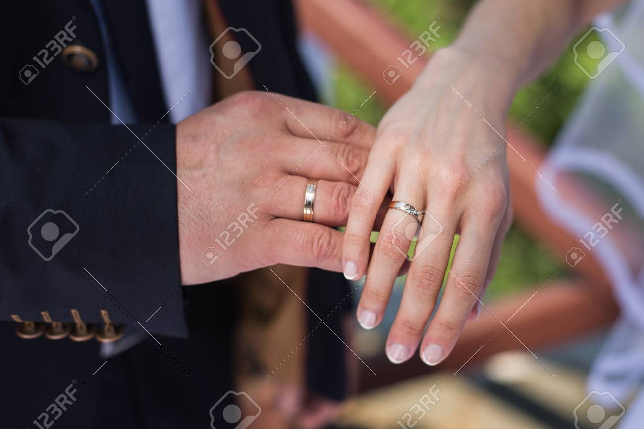 Wedding Rings On Their Hands A Ring On The Finger The Bride Stock