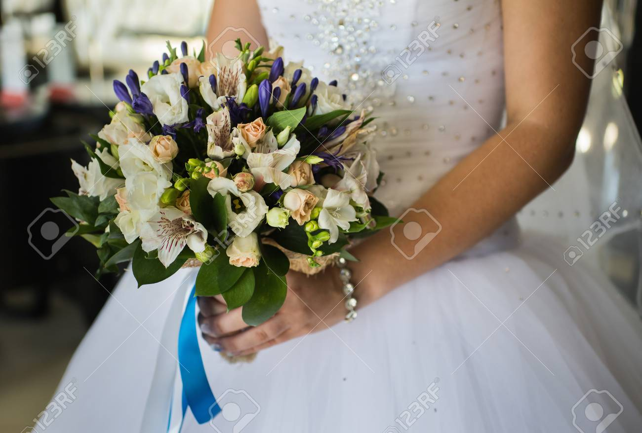 Wedding flowers girl bride holding bouquet of white flowers stock stock photo wedding flowers girl bride holding bouquet of white flowers and white yellow milk roses bouquet of roses bridal bouquet bride morning izmirmasajfo