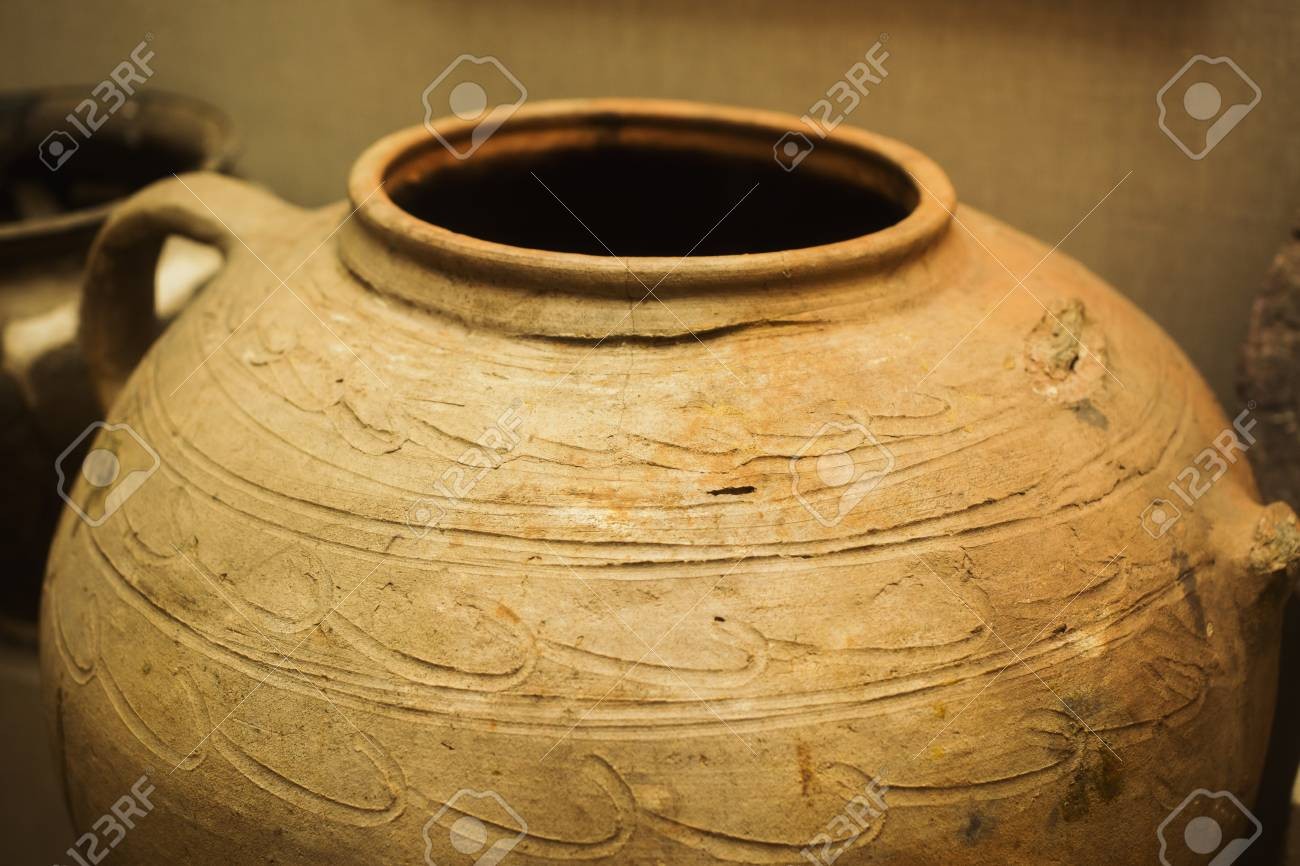 Clay ancient jug with a pattern  Old dishes  A vessel for water