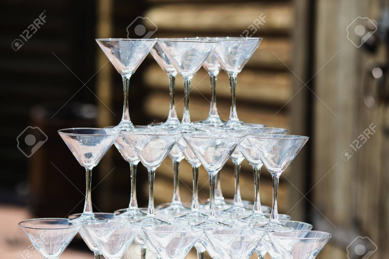 Beautiful Wedding Ceremony Outdoors Empty Wine Glasses On A Table Are A Pyramid Stock Photo