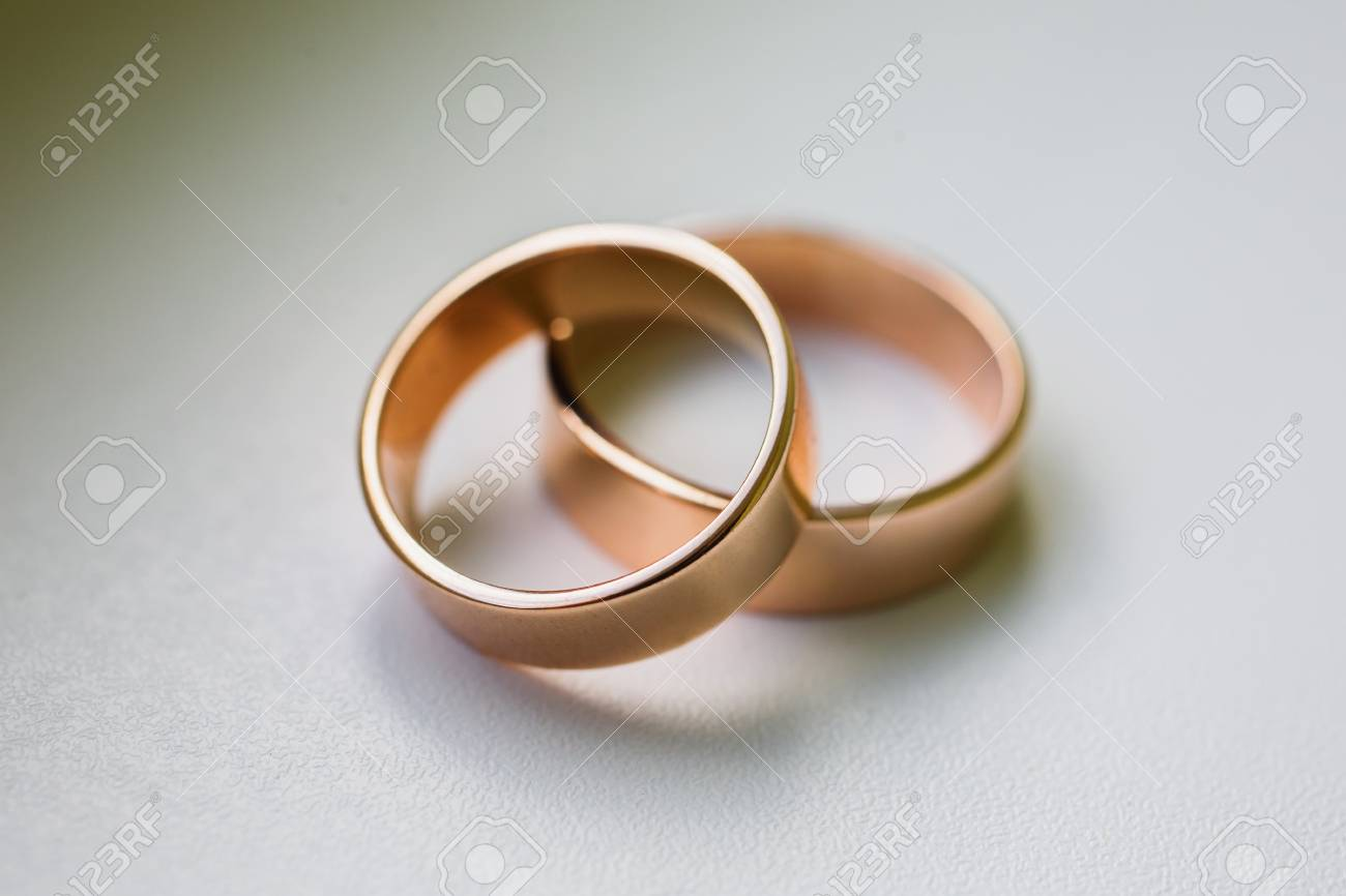 Stock Photo Wedding Rings On A White Background Bands Infinity Sign Of The: Cross Backround Wedding Bands At Websimilar.org