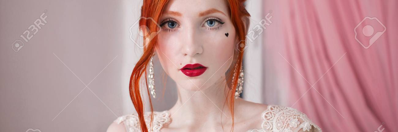 red-haired girl in a wedding dress, bright unusual appearance, red nails,