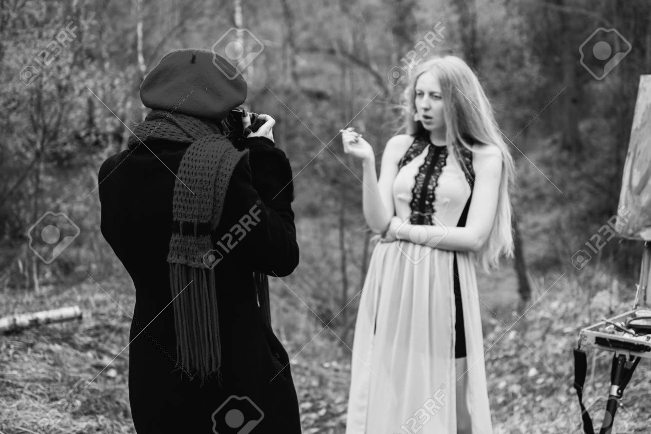 Black and white art photography monochrome blonde girl in a dress with a cigarette in