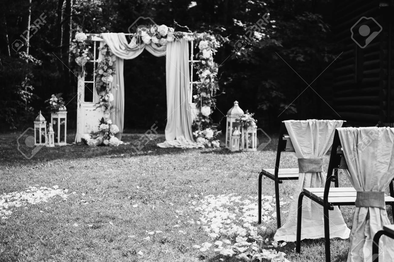 Black and white art photography monochrome beautiful wedding ceremony outdoors wedding arch made of