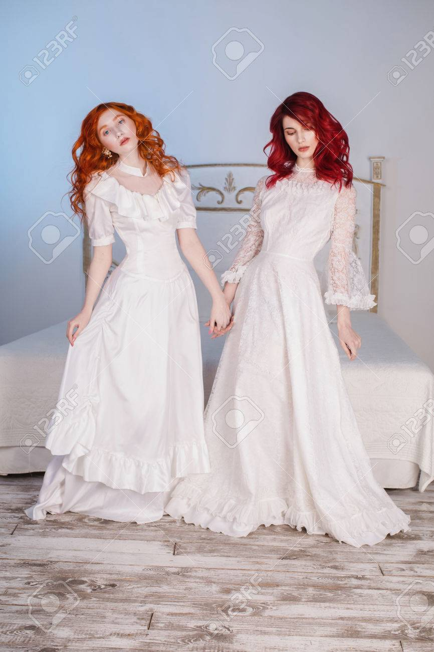 Two Beautiful Girls With Red Hair In A Beautiful White Wedding ...