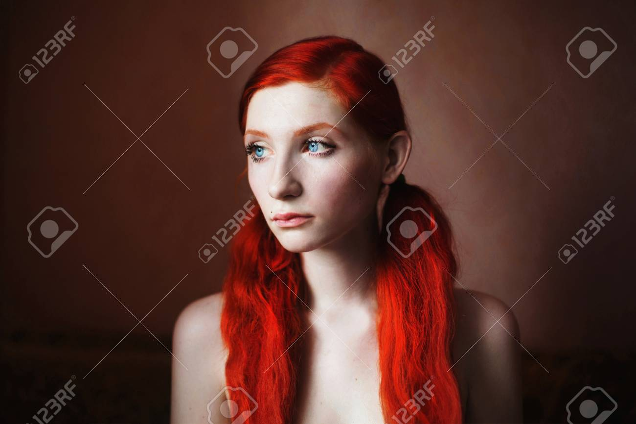 Woman With Long Red Hair Without Clothes With Natural Light
