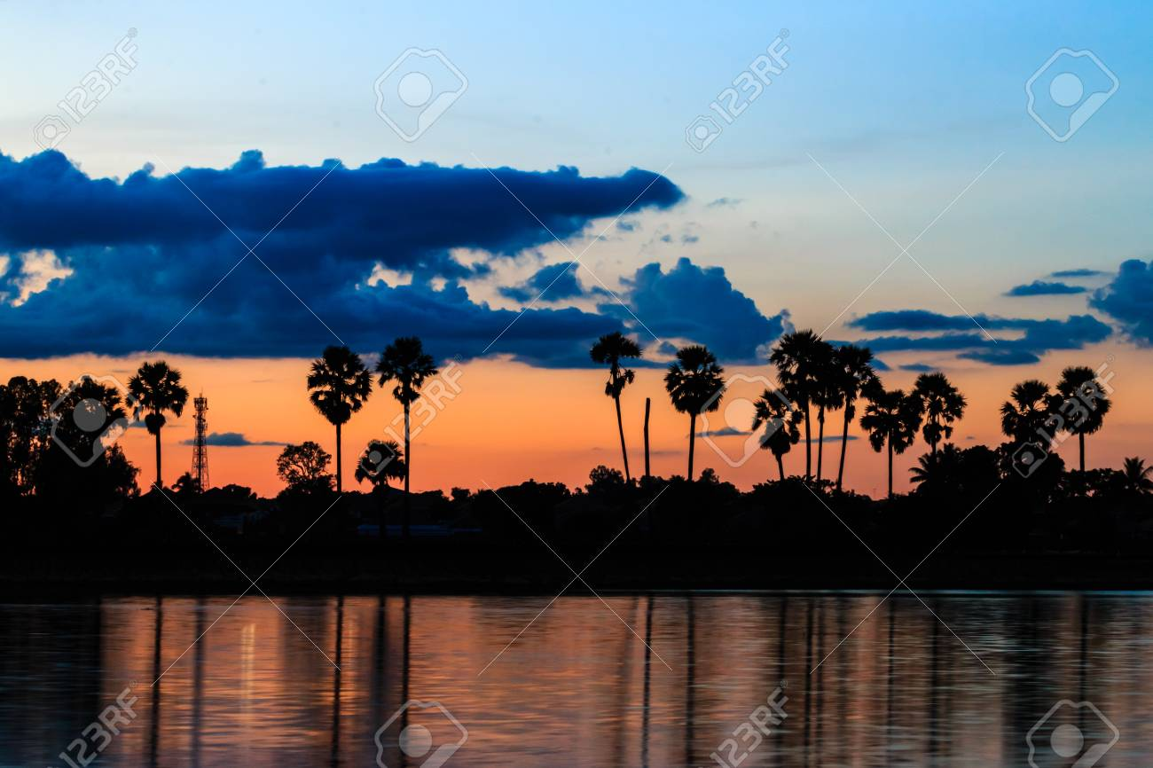 Twilight sky with reflection at the park of Sisaket, Thailand - 33655119