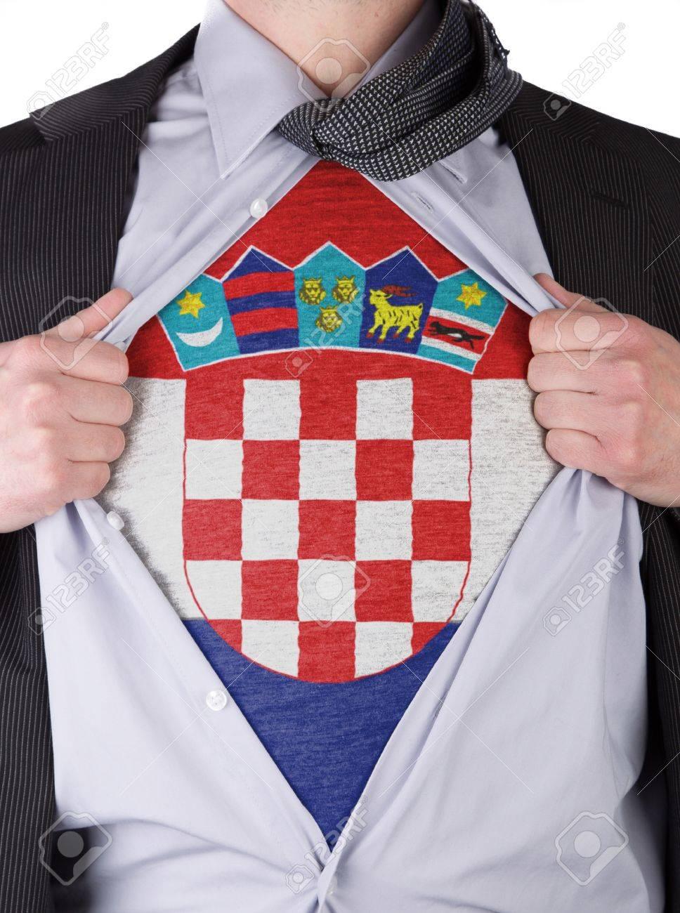 Business man rips open his shirt to show his Croatian flag t-shirt Stock Photo - 17541362