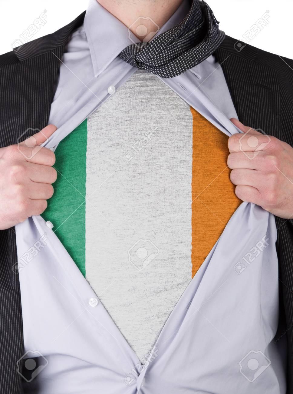 Business man rips open his shirt to show his Irish flag t-shirt Stock Photo - 17541359