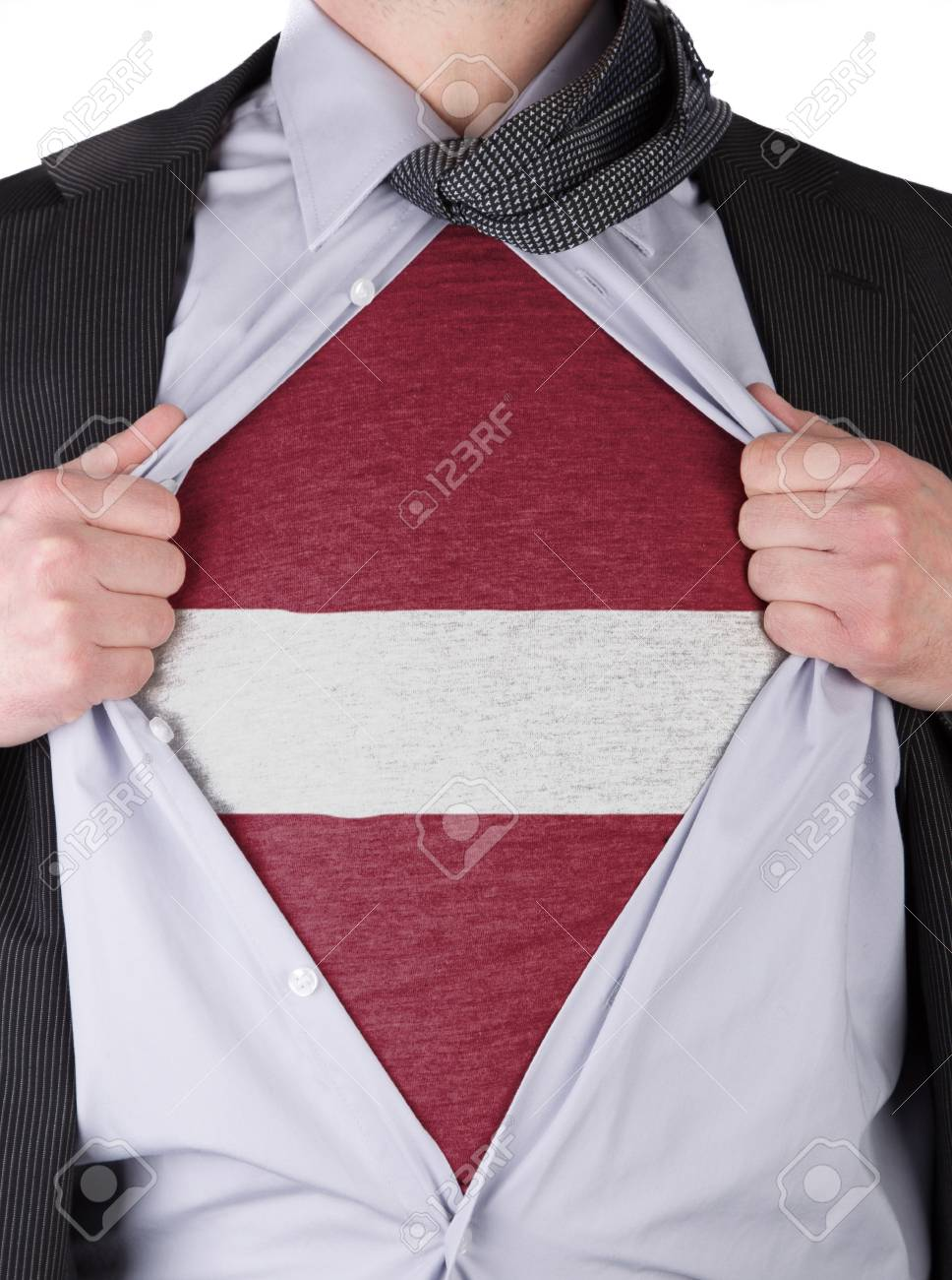 Business man rips open his shirt to show his Latvian flag t-shirt Stock Photo - 17541372