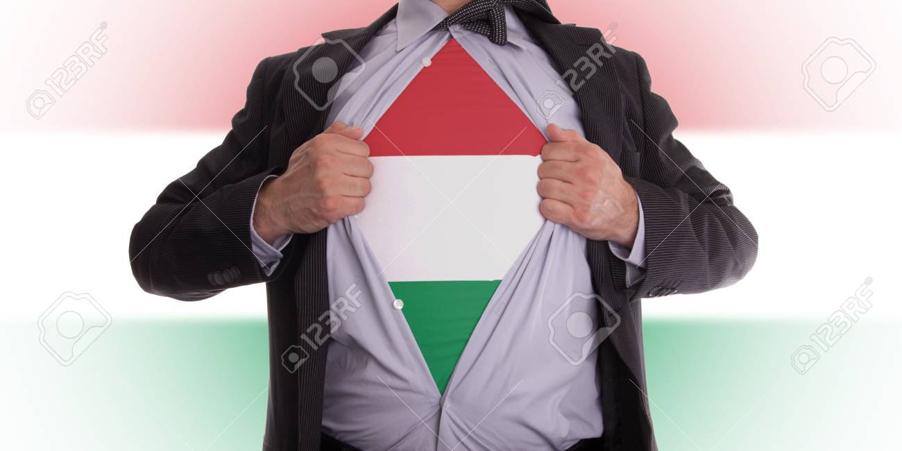 Business man rips open his shirt to show his Hungarian flag t-shirt Stock Photo - 18304997