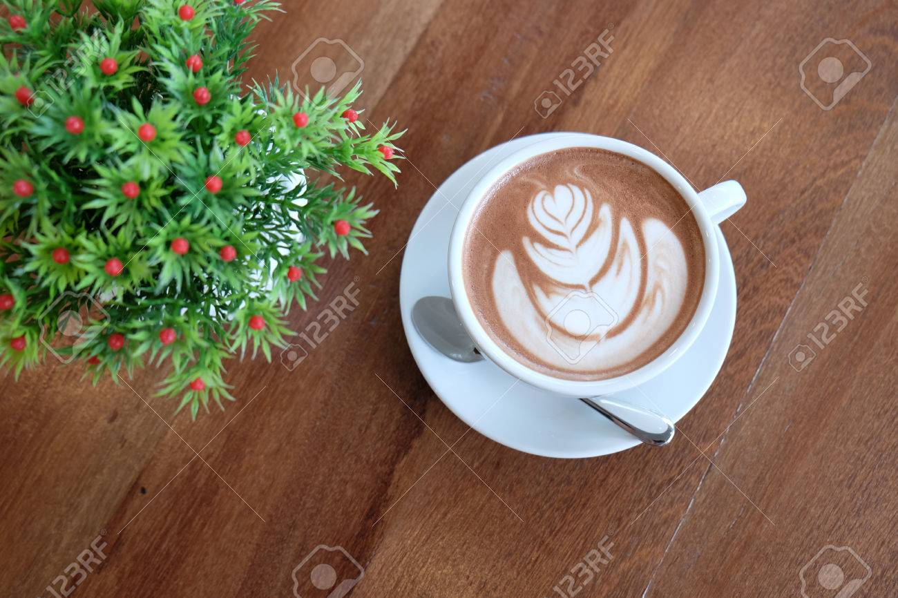 A White Cup Of Beautiful Hot Cocoa Or Hot Chocolate Milk On Wooden