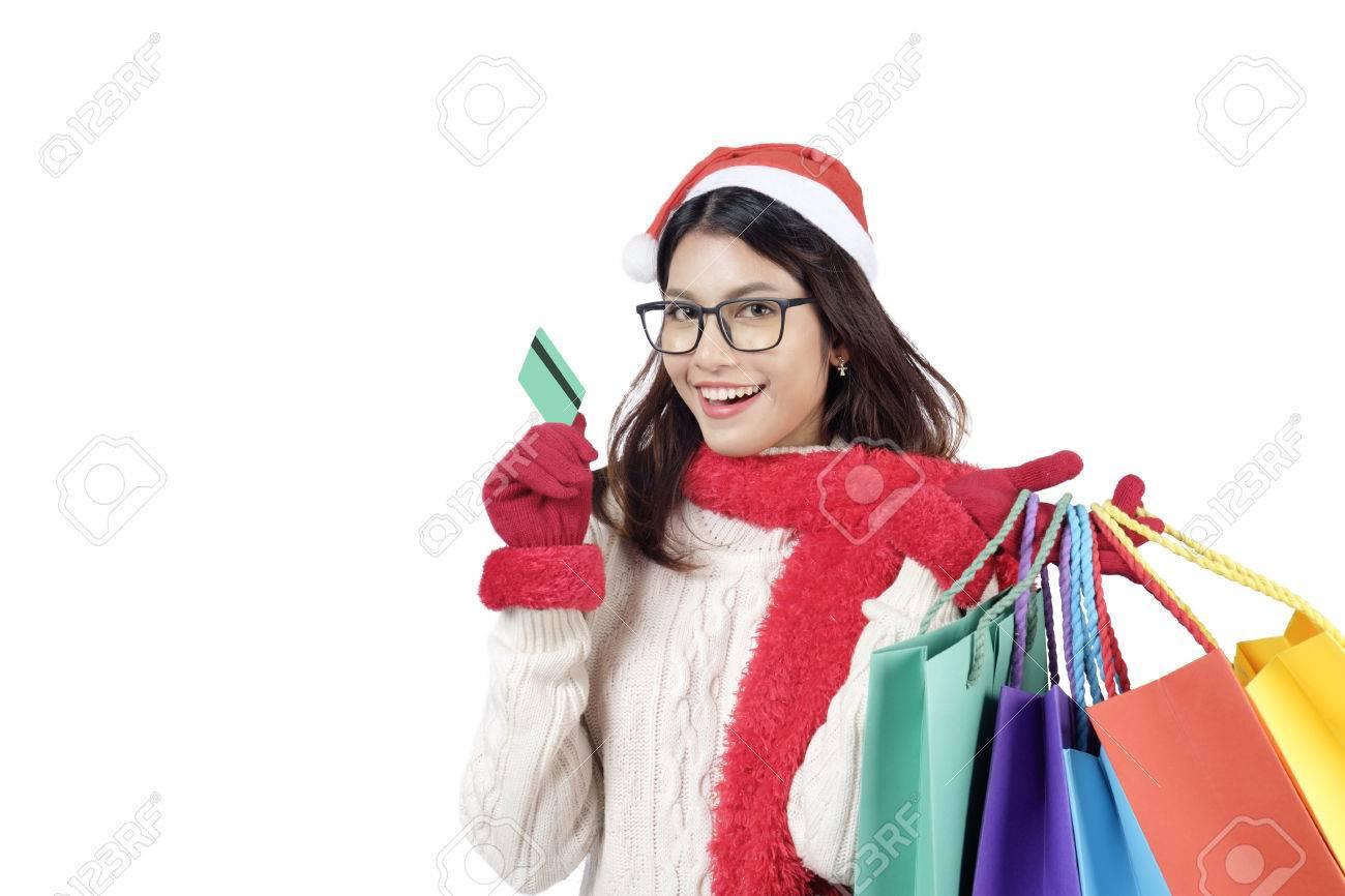 Weihnachtseinkauf. Happy Girl Mit Kreditkarte Im Einkaufszentrum ...