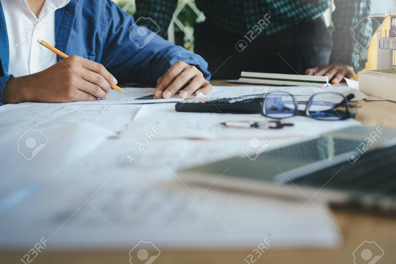 Image of engineer meeting for architectural project working with partner and engineering tools on workplace. - 135091793