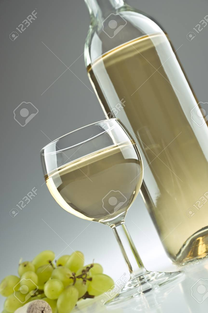 Bottle and a glass of white wine Stock Photo - 10268496