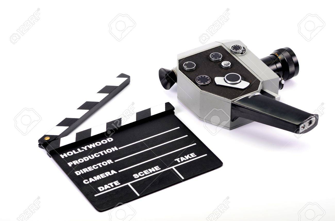 Old camera and movie clapper board, isolated , movie industry concept Stock Photo - 17102187