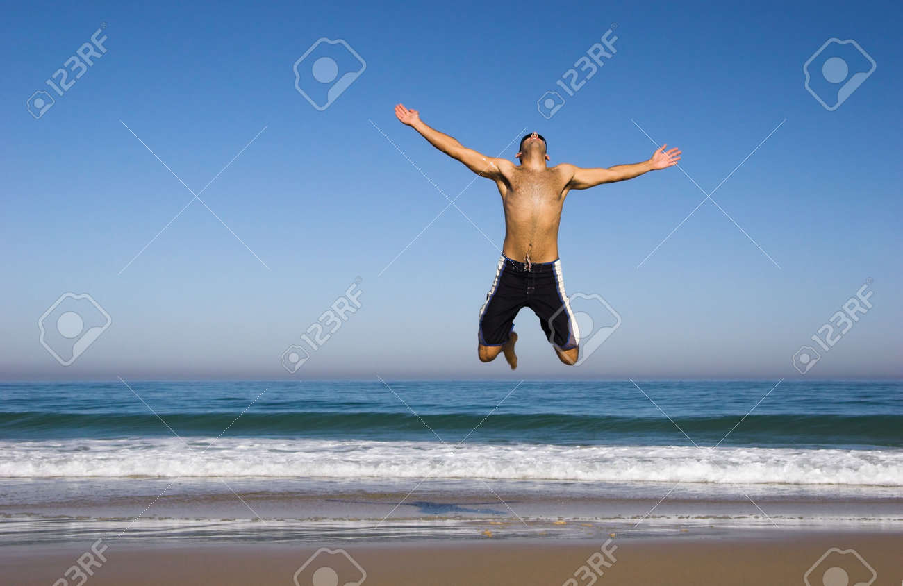 Man running and jumping on the beach Stock Photo - 430658