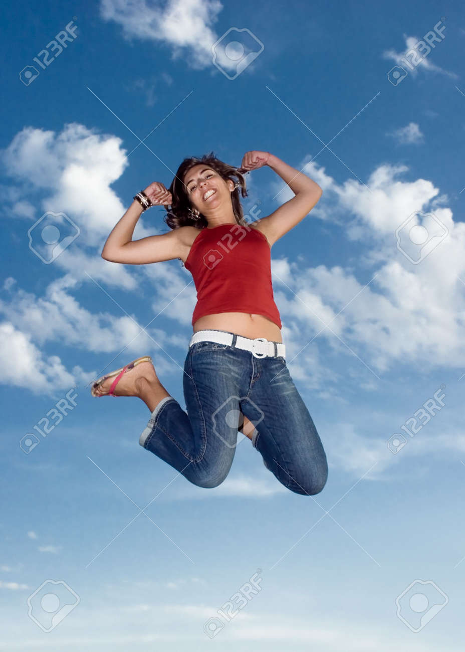 Young beautiful woman jumping to the sky Stock Photo - 531745