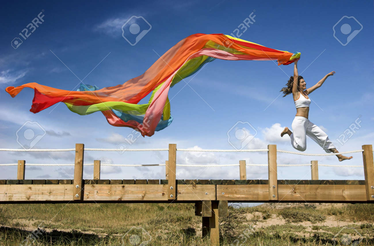 Young beautiful woman jumping with a scarf Stock Photo - 1207257
