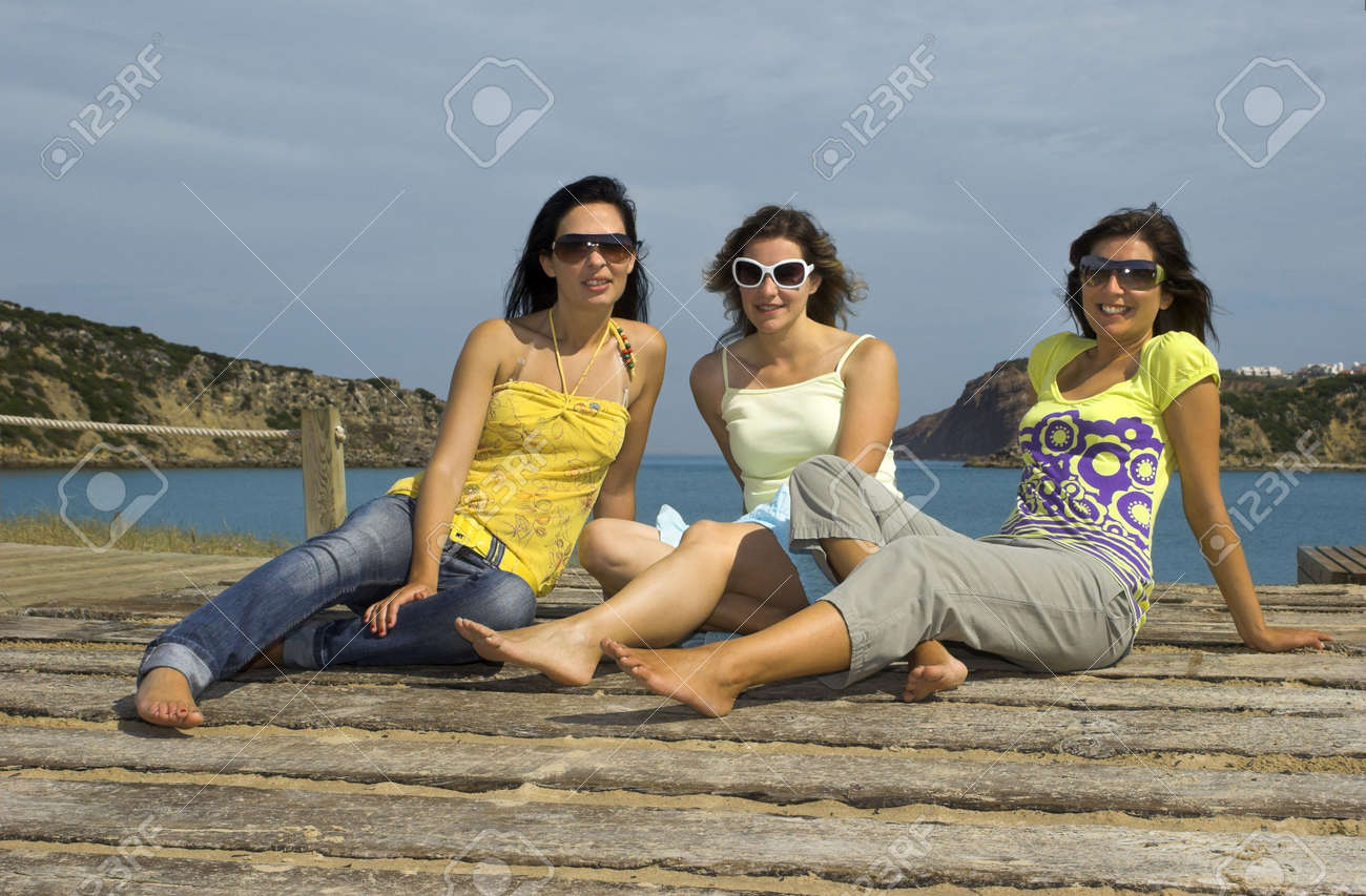 Three young girls with a beautiful beach on the  background Stock Photo - 3182958