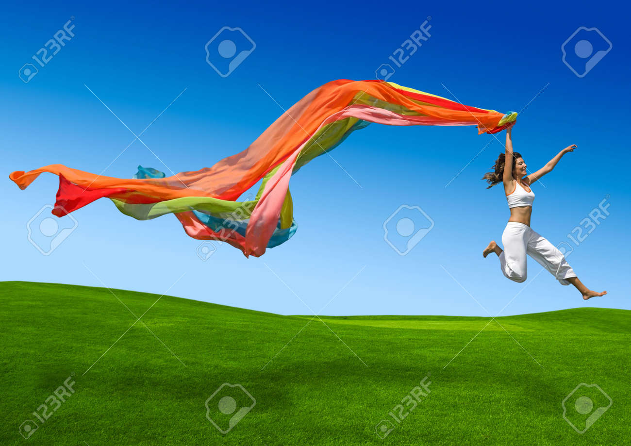 Young beautiful woman jumping with a scarf Stock Photo - 4851324
