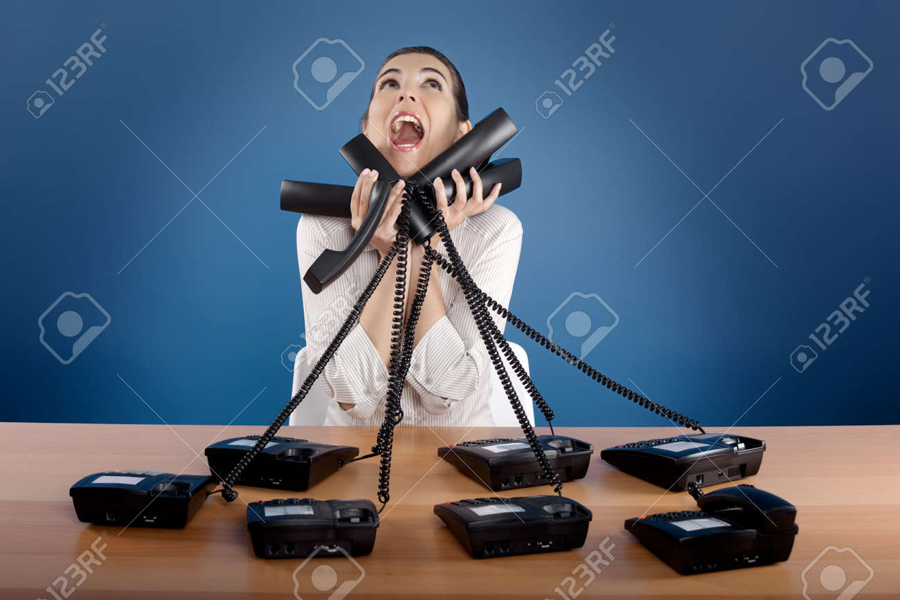 Businesswoman answering a lot of calls at the same time Stock Photo - 4917889