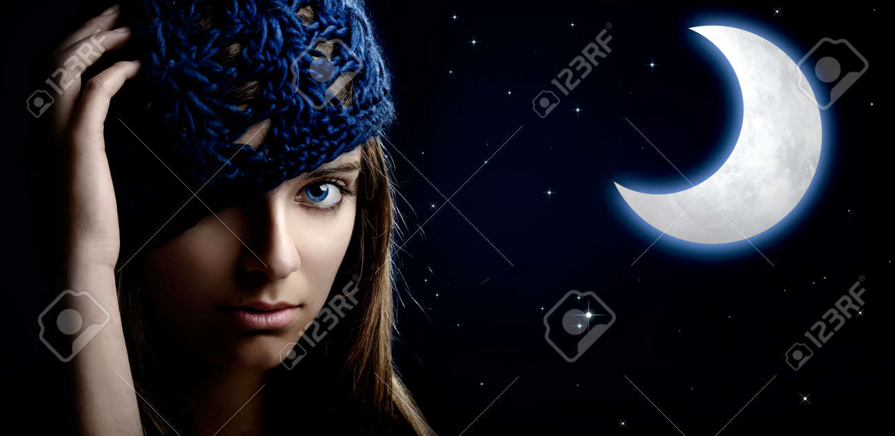 Portrait of a beautiful and young woman at night with a artifical moon on the background Stock Photo - 5227366