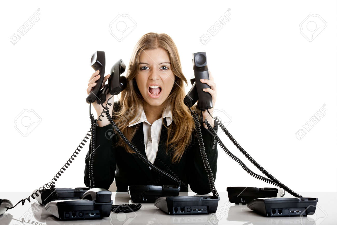 Beautiful woman working on a helpdesk answering a lot of calls at the same time Stock Photo - 5350919