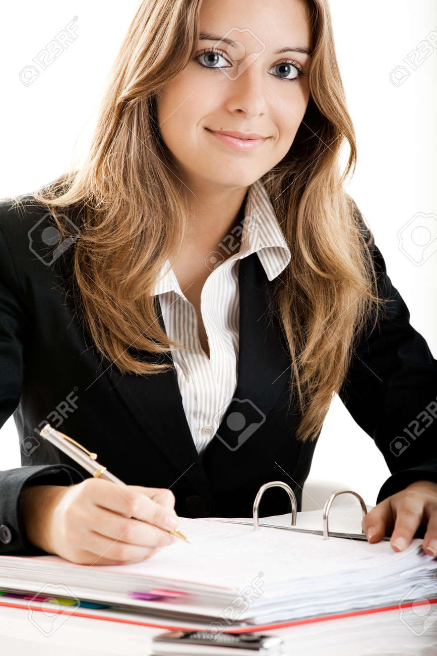 Portrait of a beautiful business woman in the office doing some paperwork Stock Photo - 5350945