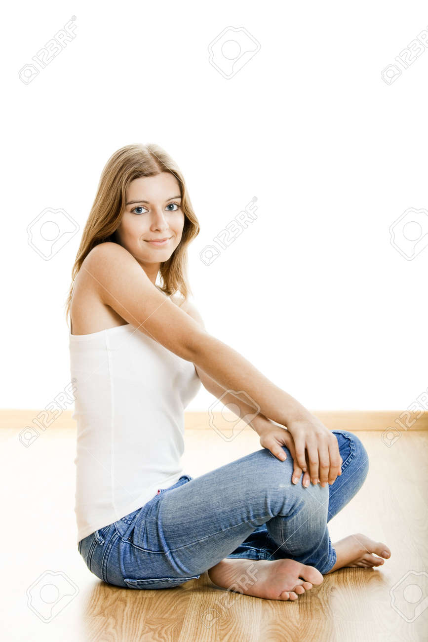 Portrait of a sexy young woman sitting on floor isolated over white background Stock Photo - 5429348