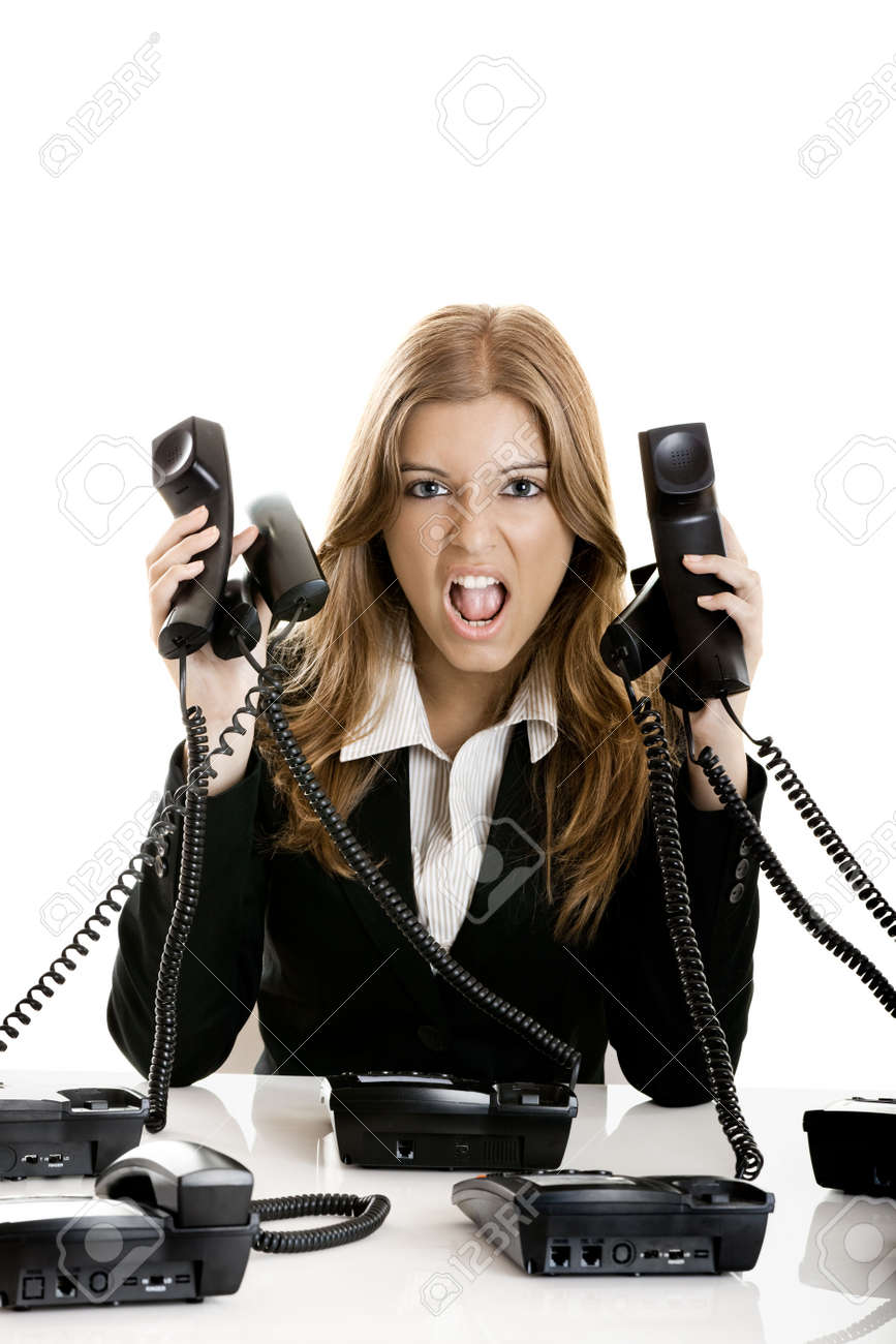 Beautiful woman working on a helpdesk answering a lot of calls at the same time Stock Photo - 6143462