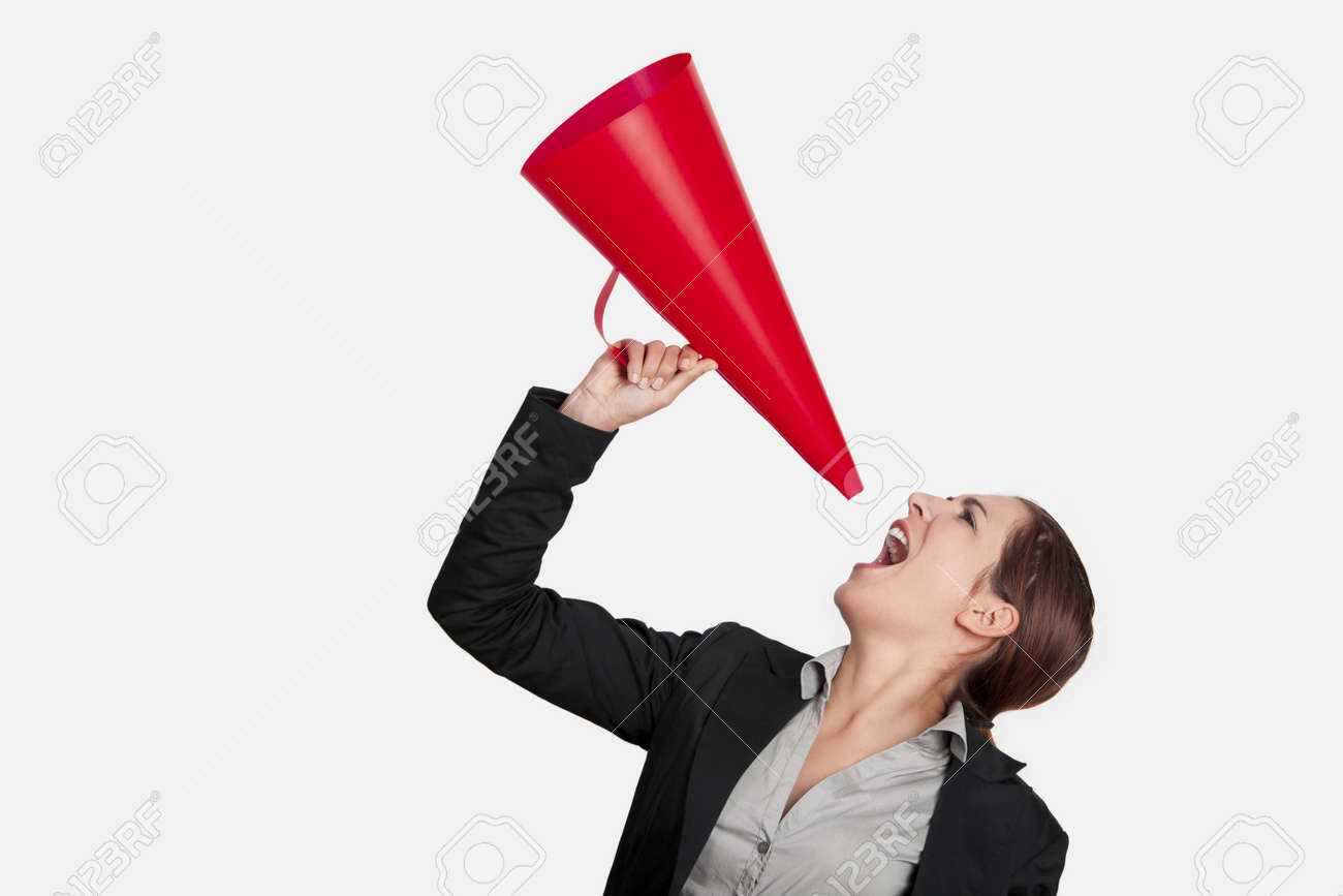 Business young woman speaking to a megaphone, isolated on white Stock Photo - 8875867