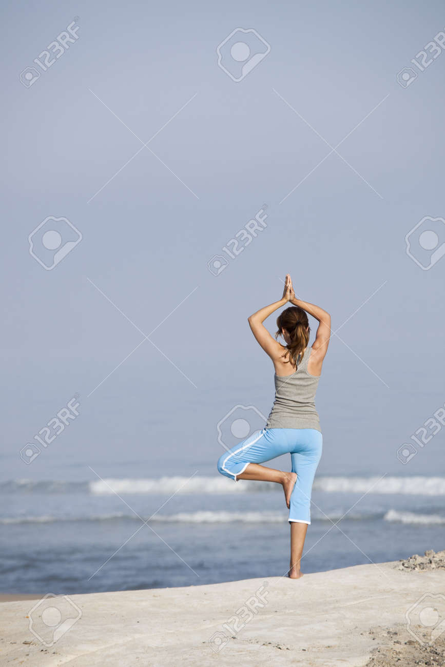 Beautiful young woman with arms open, relaxing on the beach Stock Photo - 8990135