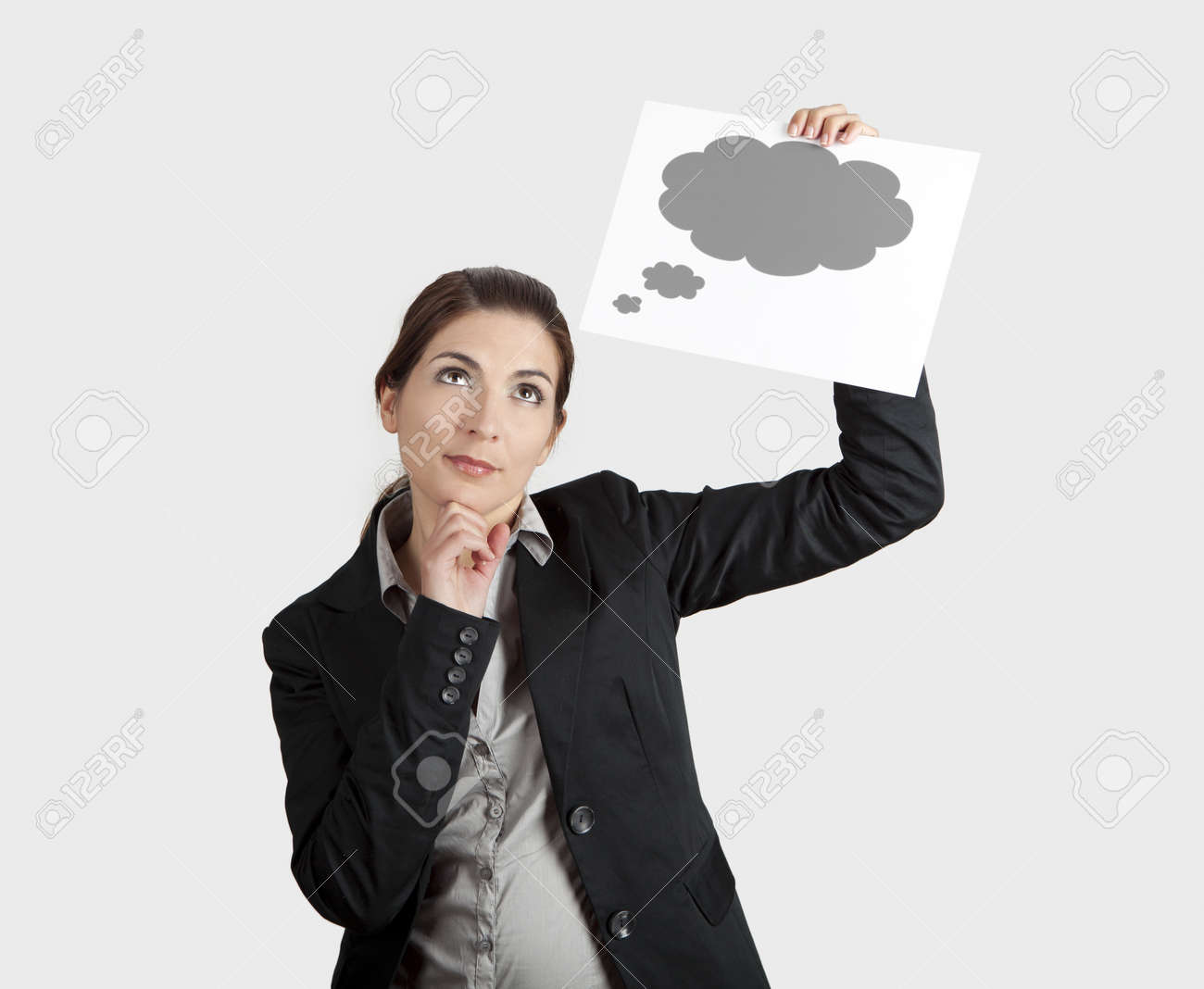 young businesswoman holding a sheet of paper with a thought ballon Stock Photo - 8990027