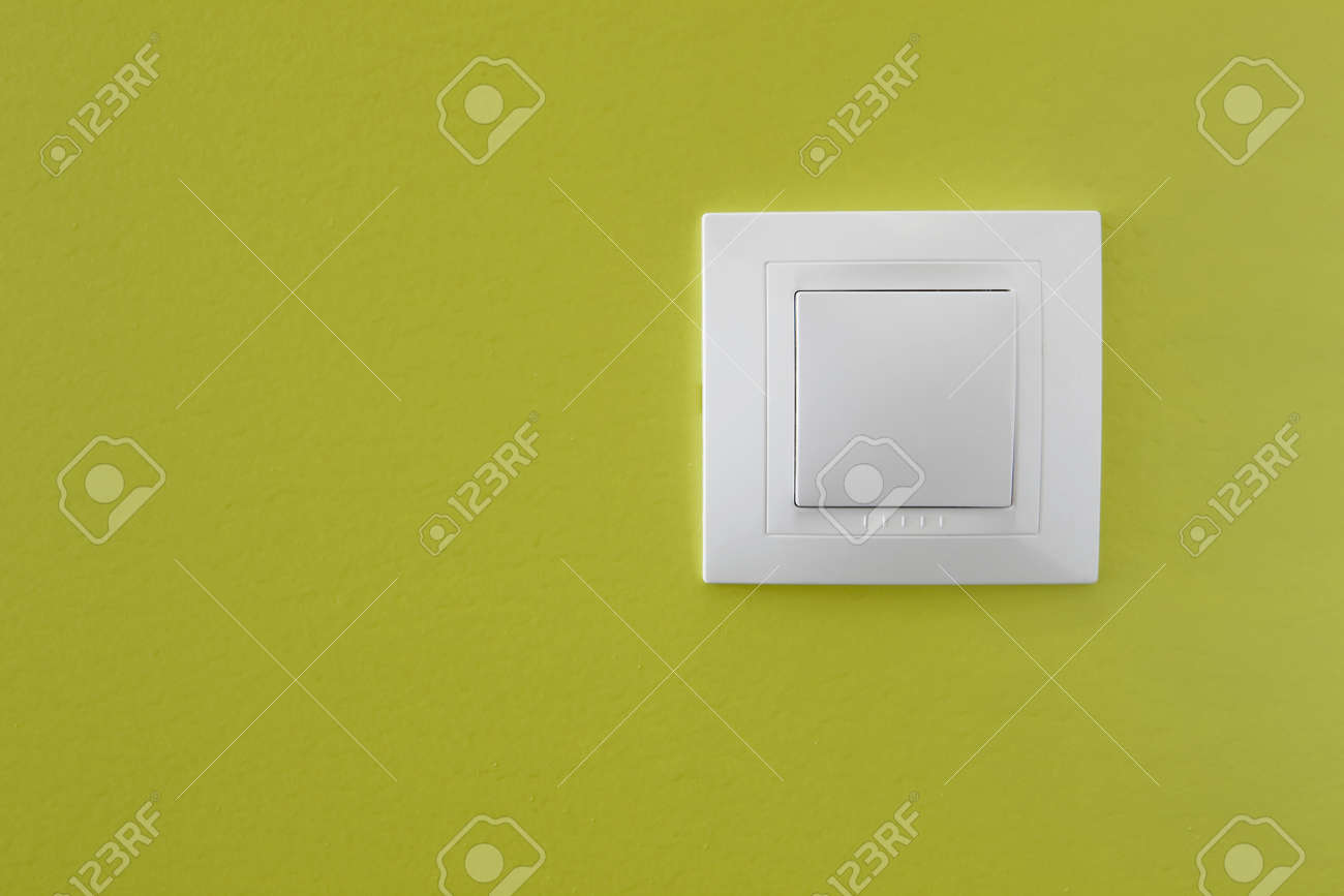 Simple light switch on a green wall Stock Photo - 9646049
