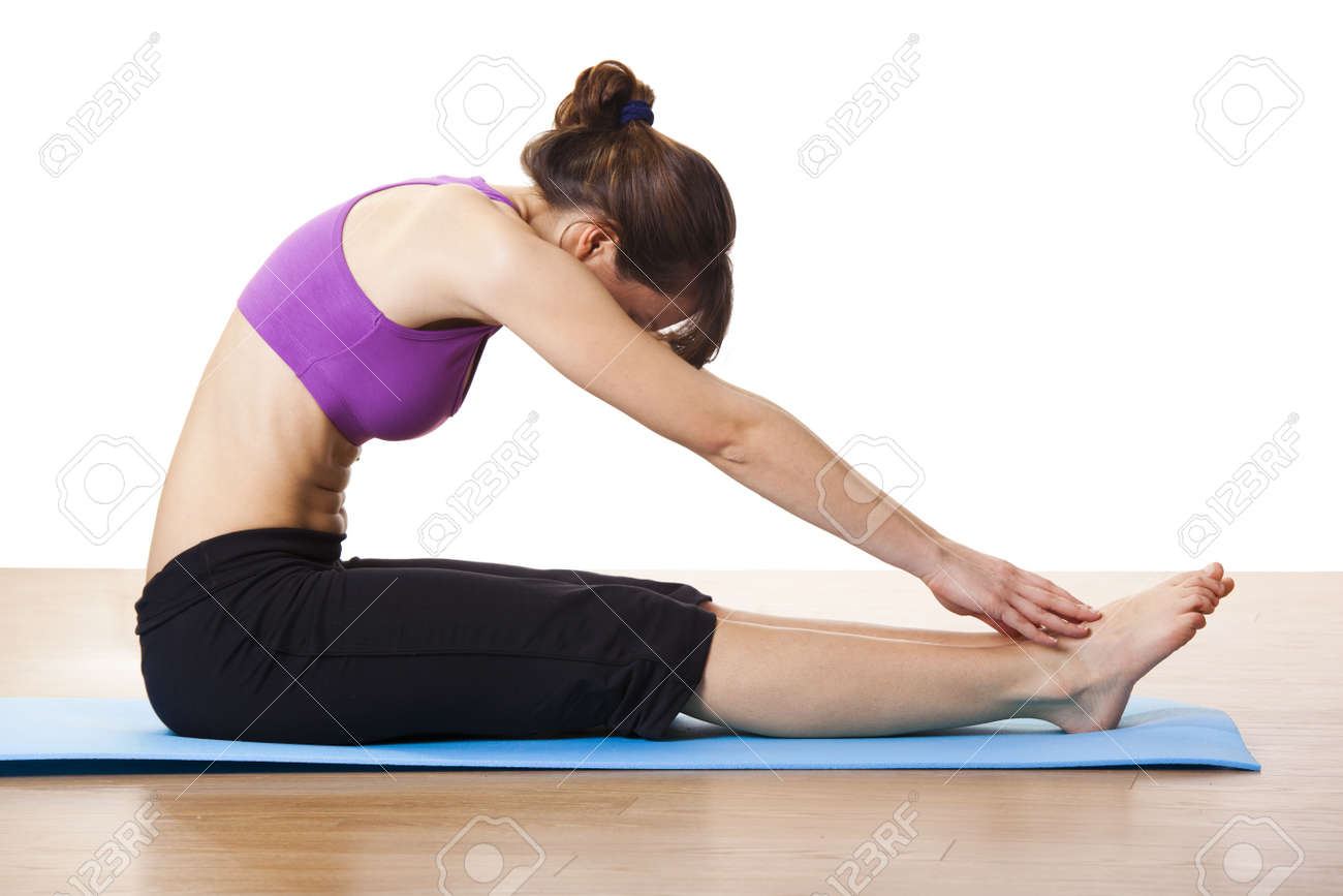 Beautiful and athletic young woman doing fitness exercises Stock Photo - 10017633