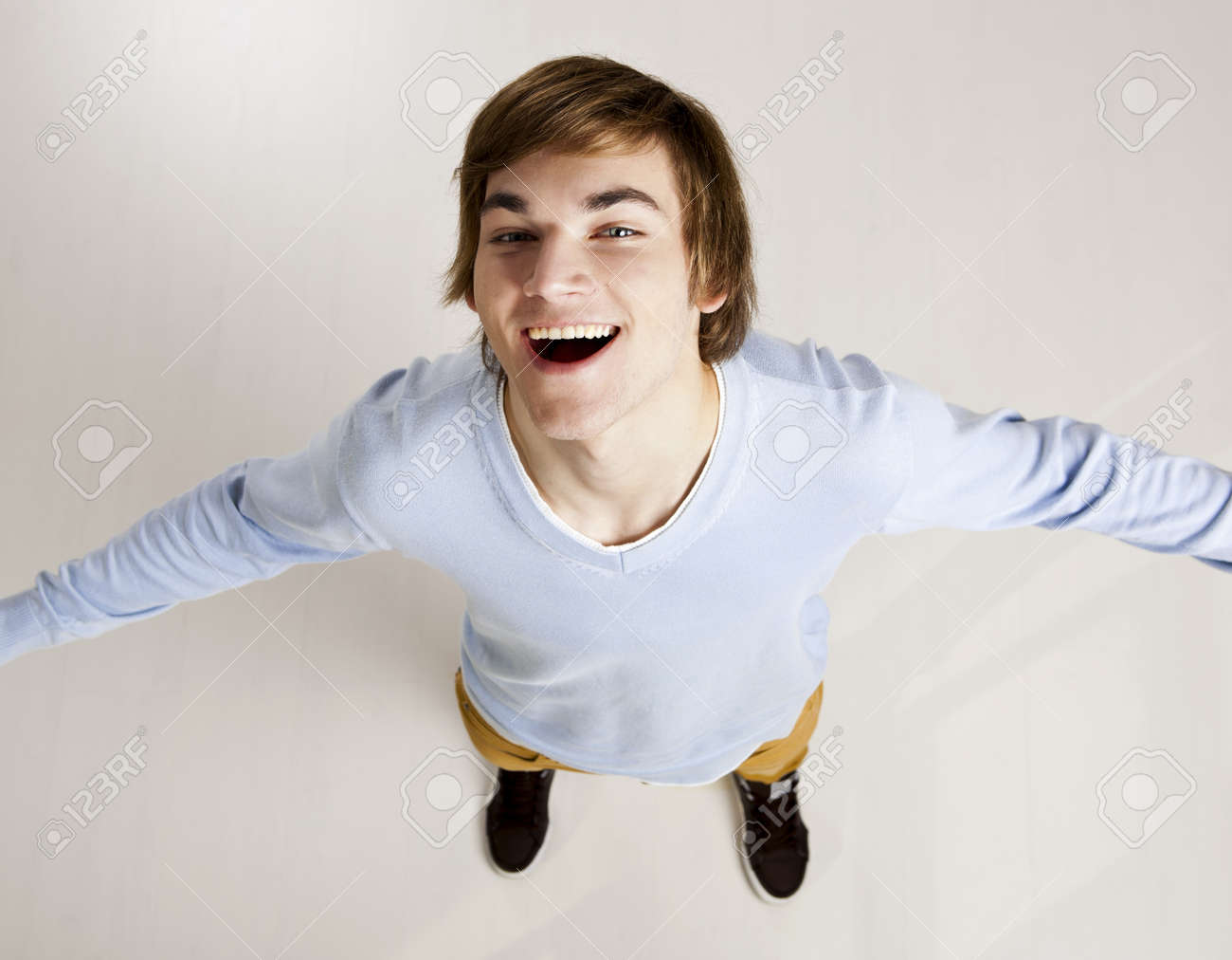 Portrait of a handsome young man looking up and laughing Stock Photo - 12436258
