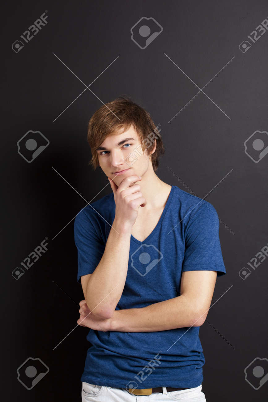 Portrait of a young man thinking over a black chalk board Stock Photo - 12670067