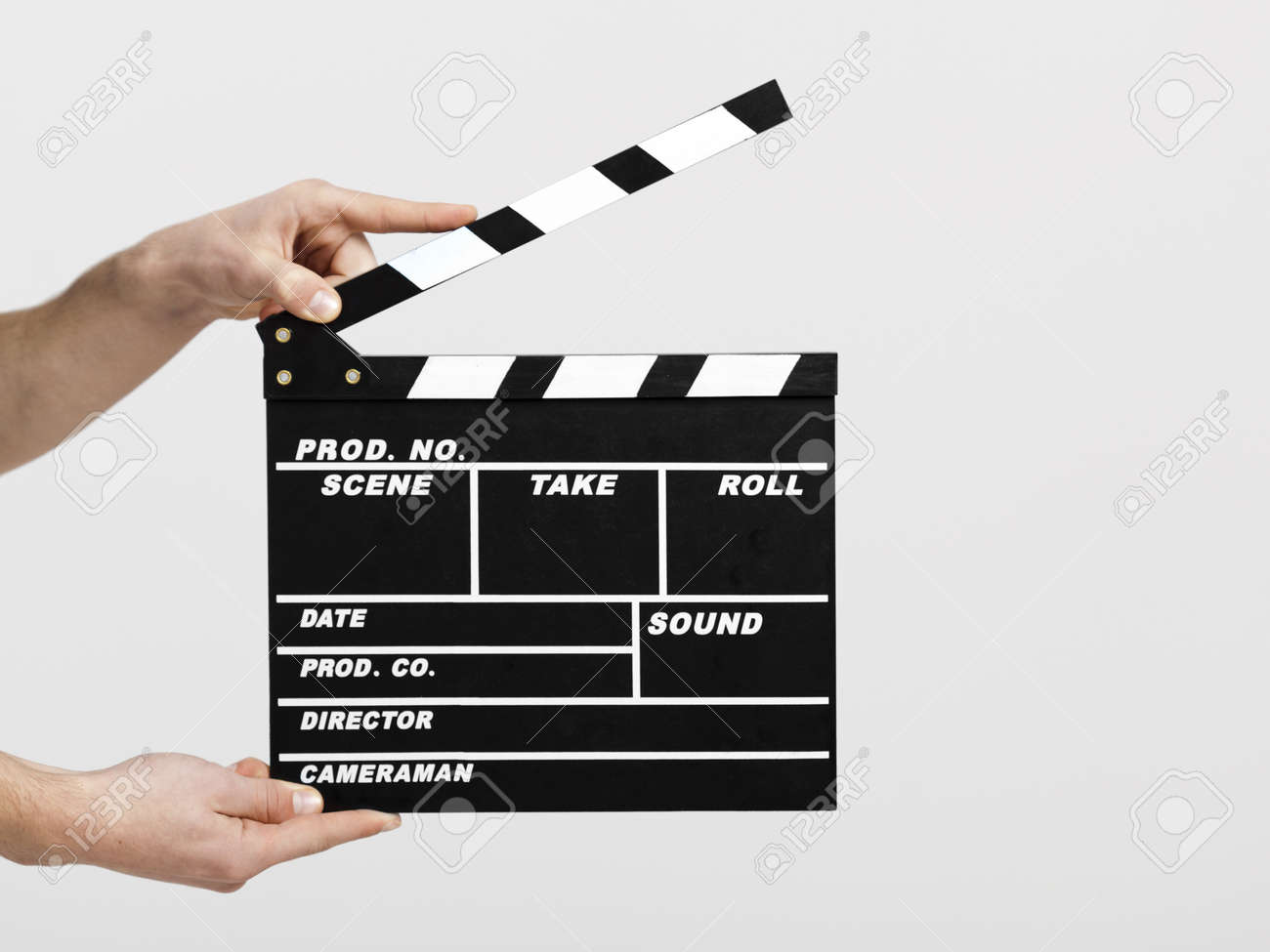 Male hands holding a clapboard, great conceptual image for ex, a new start your business - 13359209