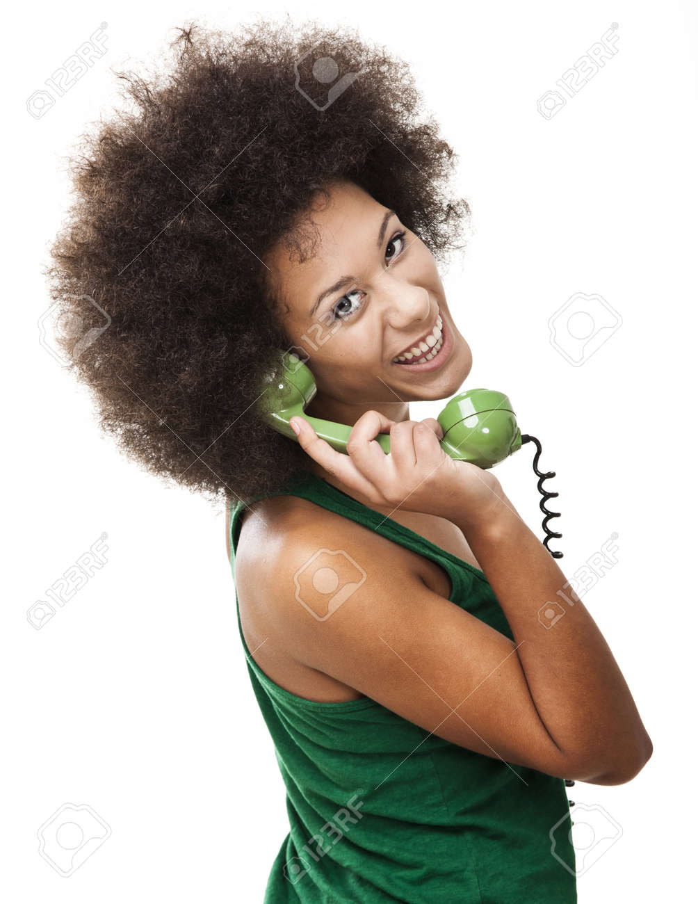 Afro-American young woman answering a call, isolated on white background Stock Photo - 15264722